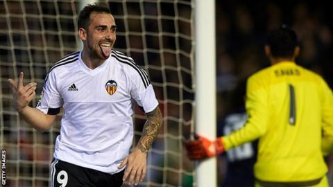 Valencia striker Paco Alcacer celebrates scoring a goal