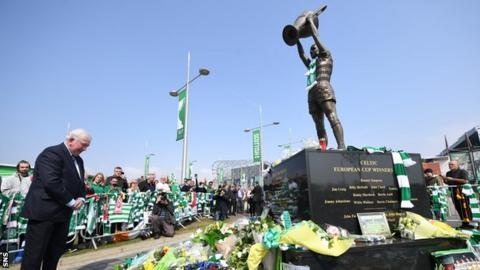 Rangers legend John Greig lays a wreath at Billy McNeill's statue