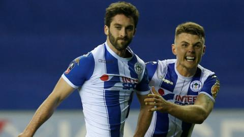 Wigan's Will Grigg celebrates