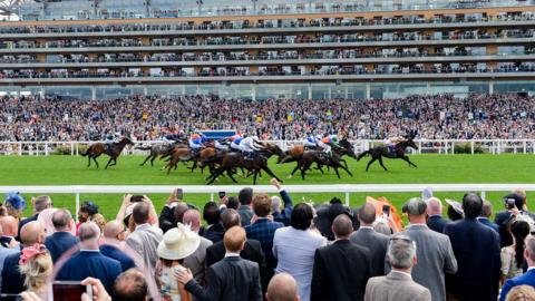 ASCOT, ENGLAND - JUNE 20: A general view of racegoers watching a race from the Village Enclosure on day 3 of Royal Ascot at Ascot Racecourse on June 20, 2019 in Ascot, England. (Photo by Stuart C. Wilson/Getty Images for Ascot Racecourse )