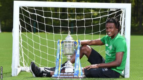 Celtic defender Dedryck Boyata poses with the Scottish Cup