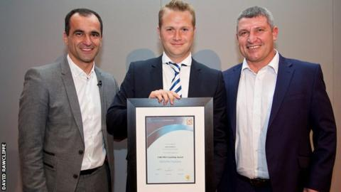 Former Swansea City manager Roberto Martinez (left) and Wales assistant Osian Roberts (right) present James Rowberry (centre) with his pro-licence certificate in 2014
