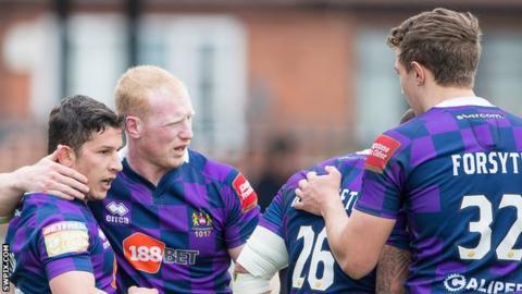 Wigan celebrate Morgan Escare's try