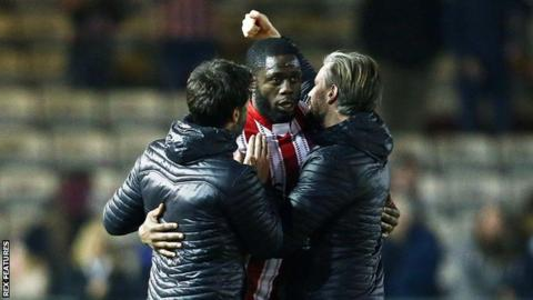 John Akinde is congratulated by Danny Cowley (left) after scoring his dramatic leveller