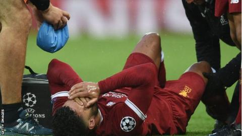 Liverpool's Alex Oxlade-Chamberlain stretchered off against Roma