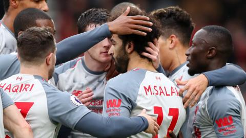 Liverpool's players celebrate scoring against Bournemouth