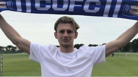 Danny Collinge poses with a Colchester scarf