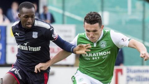 Dundee's Glen Kamara challenges Hibs' John McGinn