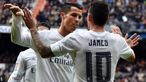 Cristiano Ronaldo and James Rodriguez celebrate