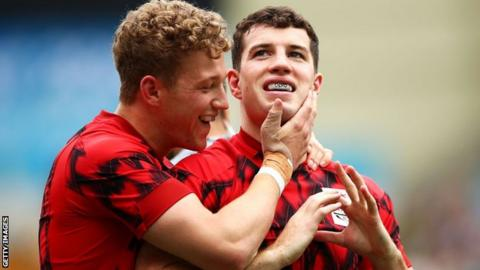 Angus O'Brien and Owen Jenkins of Wales celebrate a try during Rugby Sevens at the Commonwealth Games
