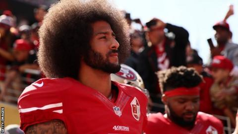 National Football League star Colin Kaepernick gets Amnesty award for kneeling protest