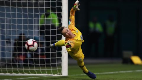 Wolfsburg, Germany, 27 March: Wolfsburg's goalkeeper Almuth Schult fails to save a penalty during the UEFA women's Champions League quarter-final, second-leg match between Vfl Wolfsburg and Olympique Lyonnais.