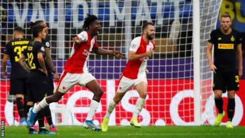 Peter Olayinka celebrates scoring against Inter Milan