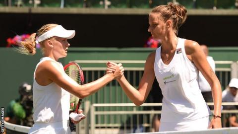 Harriet Dart shakes hands with Karolina Pliskova at Wimbledon