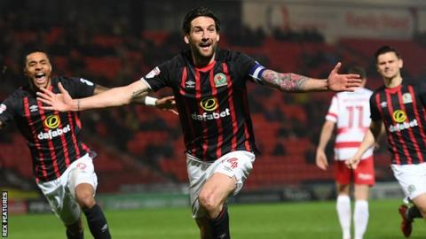 Blackburn defender Charlie Mulgrew celebrates his winning goal against Doncaster