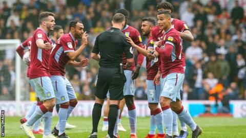 Aston Villa fans surround the referee