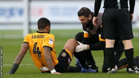 Newport midfielder Joss Labadie received treatment on his knee before being withdrawn against Forest Green