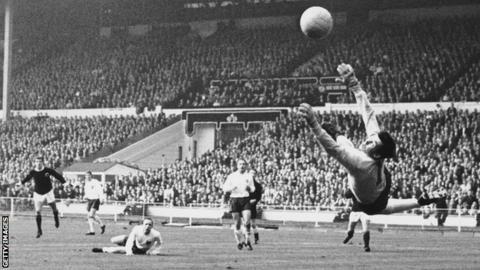 England goalkeeper Gordon Banks saves a shot from Denis Law