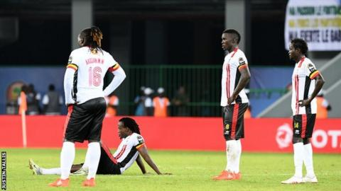 Uganda players look dejected after the defeat by Egypt
