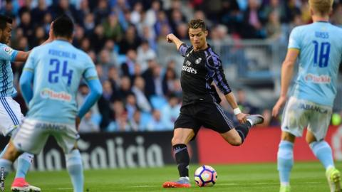 Cristiano Ronaldo scores against Celta Vigo as his team closed in on the La Liga title