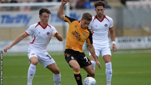 Luke Hannant of Cambridge in action against Newport