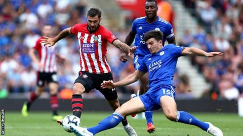 Leicester's Harry Maguire makes a tackle