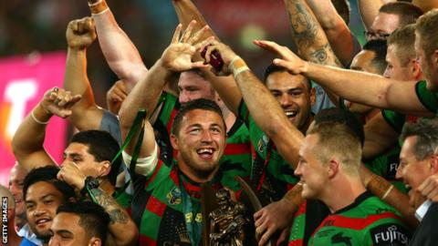 Sam Burgess celebrates winning the 2014 World Cup with his Souths team-mates