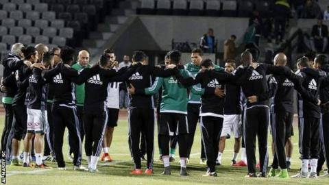 Al Masry players holding a moments silence