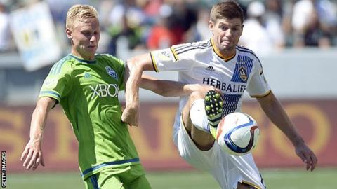 Andy Rose (left) challenges LA Galaxy's Steven Gerrard