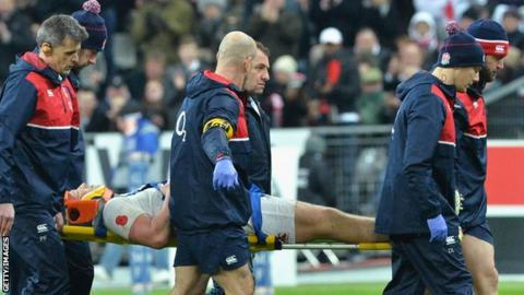 England captain Dylan Hartley is taken from the field on a stretcher