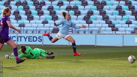 Manchester City's Gerogia Stanway scoring her first against Liverpool
