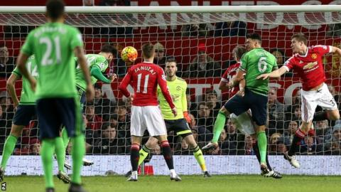 Charlie Austin heads home the winner