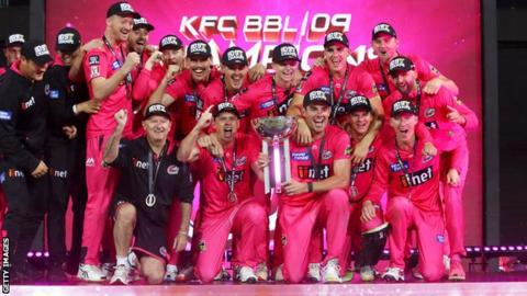 Sydney Sixers players and staff celebrate with the trophy after beating Melbourne Stars in the Big Bash final