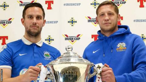 Linfield captain Andrew Waterworth with Kris Lindsay of Glenavon