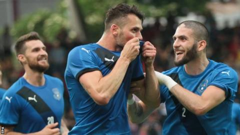 Albert Bunjaku (centre) of Kosovo celebrates scoring the opening goal