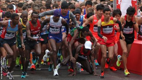 Mo Farah at the start of the World Half Marathon in Cardiff as eventual winner Geoffrey Kamworor falls
