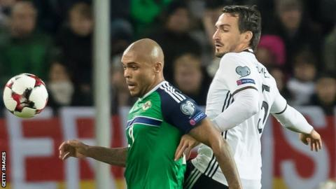 Josh Magennis battles with Germany's Mats Hummels during the World Cup qualifier in October