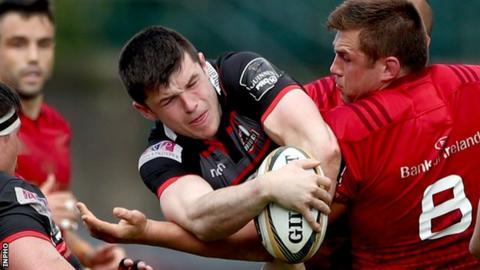 Edinburgh's Blair Kinghorn tries to escape the attention of Munster number eight CJ Stander