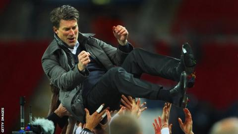 Michael Laudrup is lifted into the air by Swansea players after their 2013 Capital One Cup victory at Wembley