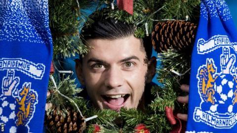 Kilmarnock midfielder Jordan Jones poses with a Christmas decoration