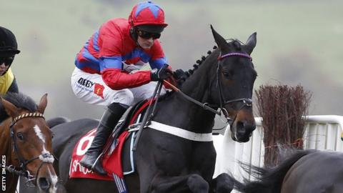 Nico de Boinville riding Sprinter Sacre on their way to winning The Shloer Steeple Chase at Cheltenham