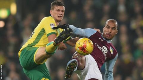 Ryan Bennett of Norwich City challenges Aston Villa's Gabriel Agbonlahor