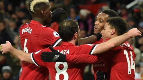 Manchester United players celebrate scoring against Stoke