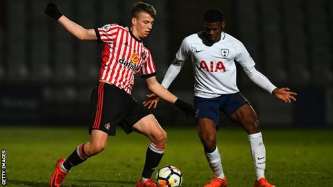 Andrew Nelson playing for Sunderland's youth team against Tottenham Hotspur's Timothy Eyoma