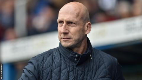 Reading manager Jaap Stam watches from the sidelines against Leeds