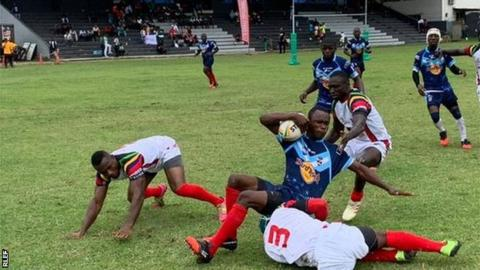 Cameroon players (in blue) in action against Ghana