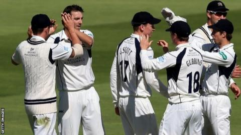 Middlesex players celebrate the wicket of Jonathan Trott, who went cheaply in the morning session