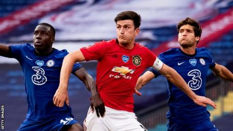 Harry Maguire of Manchester United (centre) battles with Kurt Zouma (left) and Marcos Alonso (right) of Chelsea