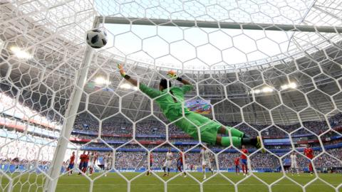 SAMARA, RUSSIA - JUNE 17: Aleksandar Kolarov of Serbia scores his team's first goal past Keylor Navas of Costa Rica from a free kick during the 2018 FIFA World Cup Russia group E match between Costa Rica and Serbia at Samara Arena on June 17, 2018 in Samara, Russia. (Photo by Dean Mouhtaropoulos/Getty Images)