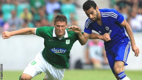 Filip Valencic (left) of Olimpija Ljubljana in action against Chelsea's Mohamed Salah